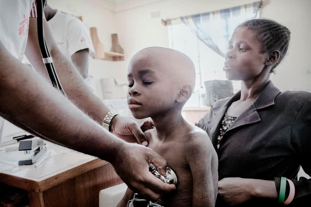 A nurse examines Gloria Chipasula, an 11-year-old living with HIV, in Chiradzulu, Malawi.