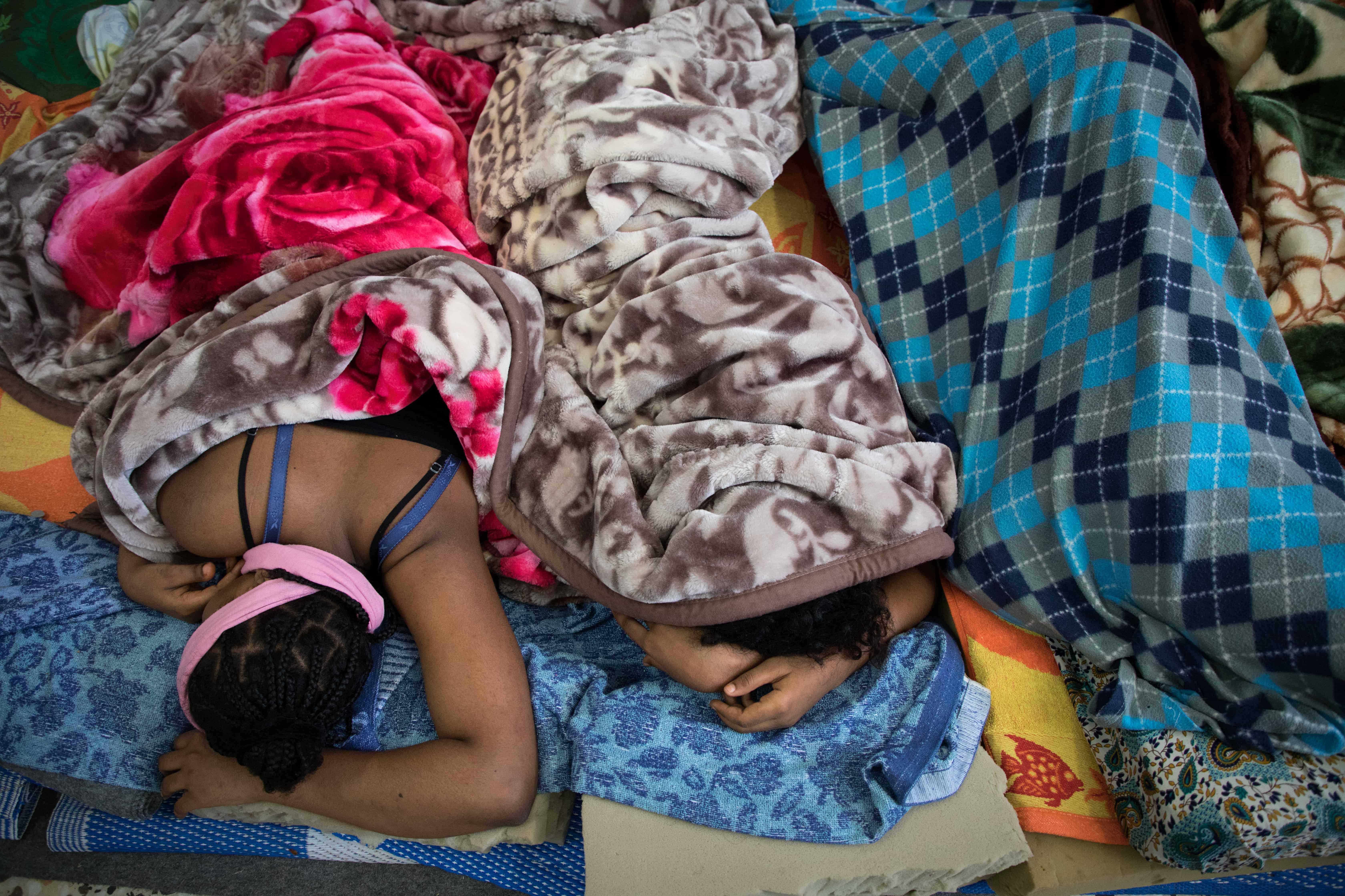 Women detainees take a nap in the Souq Al-Khamis detention centre. Khoms, Libya, October 2019. © AURELIE BAUMEL/MSF